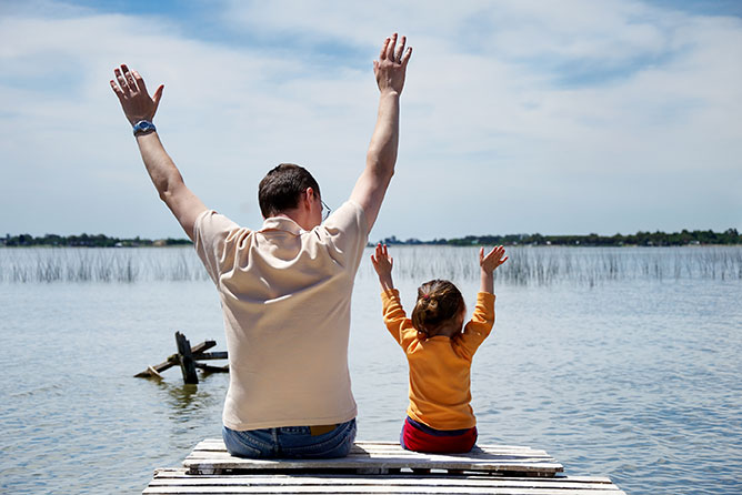 dad and daughter at a lake
