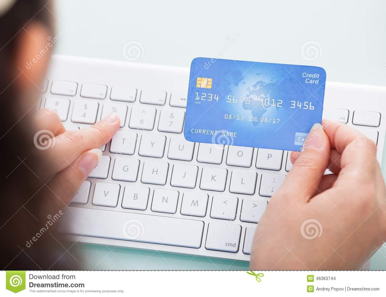woman entering credit card information